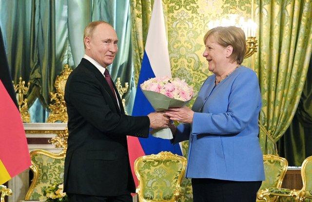 Schůzka Vladimira Putina sAngelou Merkelovou. Foto:ČTK, AP