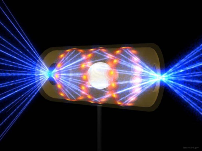 Vyfotografovat fúzi nejde, ale takhle nějak by vypadalo, kdyby to šlo. Uprostřed je nepatrná plastová kulička s palivem, umístěná v kovové trubičce. Do ní pálí nejsilnější lasery světa. Foto: NIF