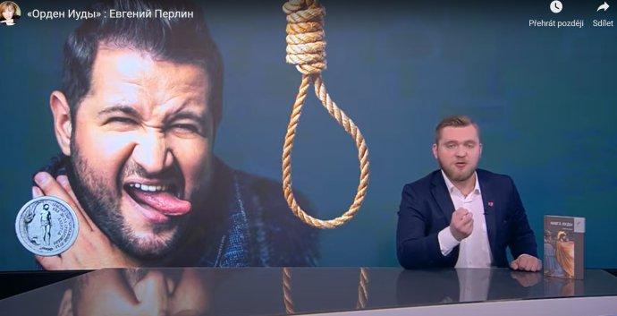 Pořad známého běloruského moderátora Grigorije Azarjonka se jmenuje Jidášův řád, vysílá ho státní kanál STV ajeho hlavním logem je oprátka. Zdroj: STV, YouTube